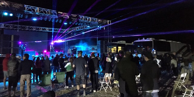 "Festival-goers at the Area 51 Basecamp in Hiko, Nev. partake in a ""psychedelic"" mix by Grammy-nominated electronic dance music DJ and recording artist Paul Oakenfold."