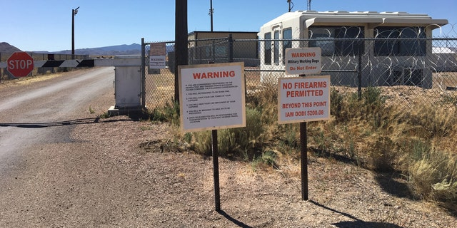 A sign warning of consequences for trespassing.