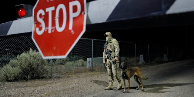 A security guard stands at an entrance to the Nevada Test and Training Range near Area 51 Friday, Sept. 20, 2019, near Rachel, Nev.