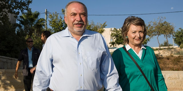 Avigdor Liberman, seen here with his wife Ella, positioned himself as a primary power broker.