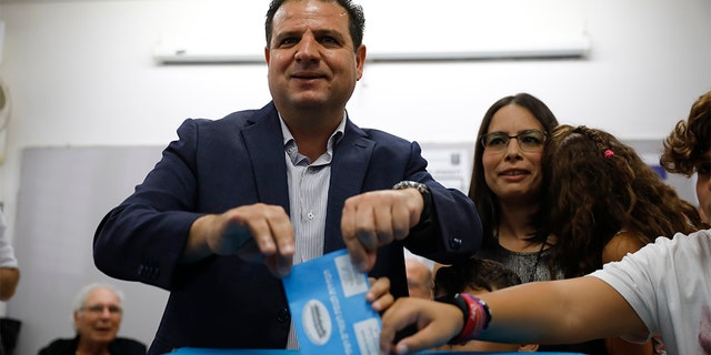 In this Tuesday, Sept. 17, 2019. file photo, Israeli Arab politician Ayman Odeh casts his vote in Haifa, Israel. Israel's Arab coalition appears poised to emerge as the main opposition bloc following Tuesday's vote. The historic first would grant a new platform to a long-marginalized minority and the only major political movement still pushing for peace with the Palestinians.