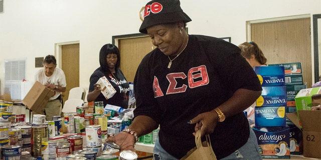 Volunteer Diane Alexander, 57, organizing donated goodsin Miami on Tuesday. (AP Photo/Ellis Rua)