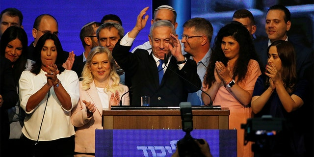 Israeli Prime Minister Benjamin Netanyahu gesturing to supporters at his Likud party headquarters early Wednesday.