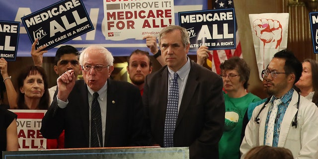 "Sen. Bernie Sanders introducing health care legislation titled the ""Medicare for All Act of 2019"" during a news conference on April 9, 2019 in Washington, D.C. (Photo by Mark Wilson/Getty Images)"