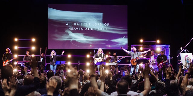 Worship during a Bethel Church service in Redding, Calif.