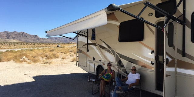"Bob and Helen Pio set up their camper near the ""Black Mailbox"" and had enough supplies to last a few days."