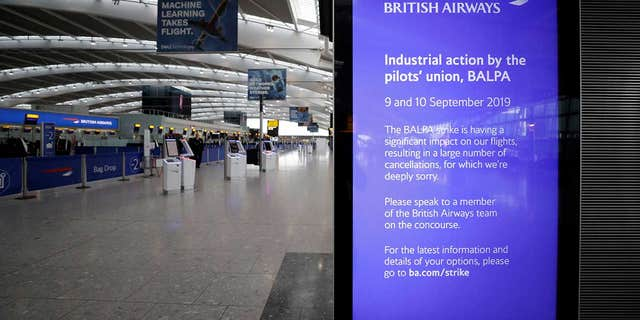 "A screen at Heathrow Airport's Terminal 5 displays a message from British Airways, which writes that it is ""deeply sorry"" about the cancelations."