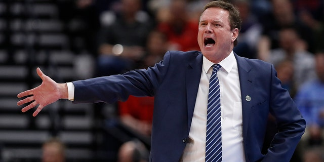 FILE - In this March 21, 2019, file photo, Kansas head coach Bill Self reacts in the first half during a first round men's college basketball game against Northeastern in the NCAA Tournament in Salt Lake City. (AP Photo/Jeff Swinger, File)