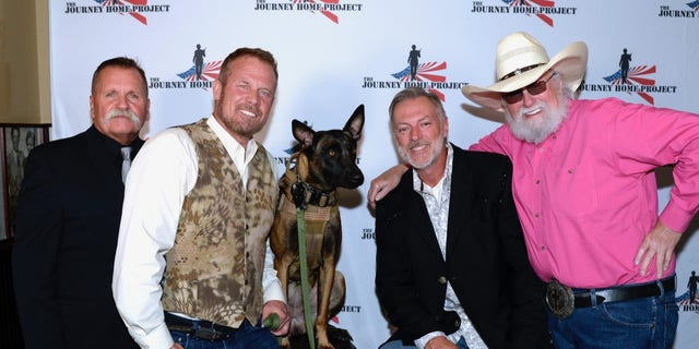 "Left to right: Charlie Daniels manager and The Journey Home Project co-founder David Corlew, Mark ""Oz"" Geist, Rone (dog) Darryl Worley and Charlie Daniels attend the second-annual ""Charlie Daniels Patriot Award Dinner"" at Palm Restaurant in Nashville on Tuesday, September 10, 2019. The event raised $200,000 for veterans."