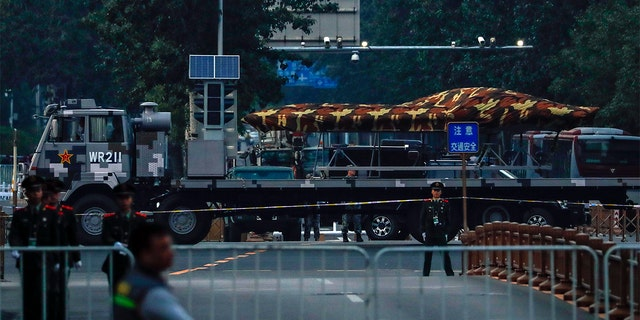 A Chinese military vehicle possibly carrying a drone passing along the Jianguomenwai Avenue last weekend during a rehearsal for the 70th anniversary of Communist China, in Beijing. (AP Photo/Andy Wong)