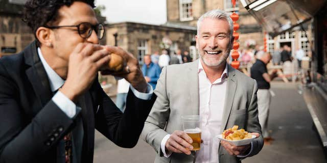 Expensive suits and sloppy street food? Bold choice, gentlemen!
