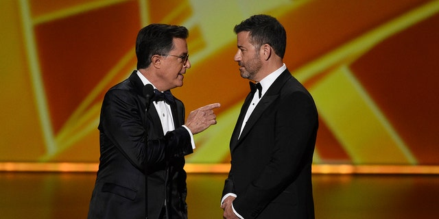 Stephen Colbert, left, and Jimmy Kimmel present the award for outstanding lead actress in a comedy series at the 71st Primetime Emmy Awards on Sunday, Sept. 22, 2019, at the Microsoft Theater in Los Angeles.