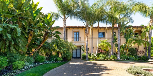 """The villa-style home, which is """"guard gated"""" in a """"unique, prestigious"""" location, measures nearly 8,000 square feet and sits on 0.75 acres."""