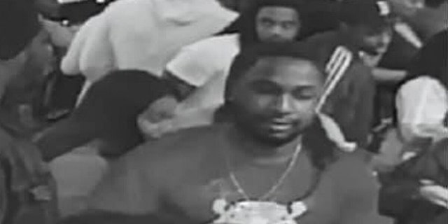 Police are on the hunt for this suspect reportedly captured on video smashing another man in the head with a bowling ball at an event in the Chicago area on Wednesday night, resulting in the victim being placed in a coma.