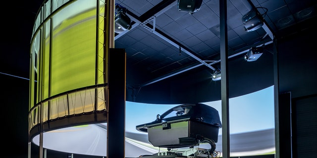 Ford engineers are testing electric vehicle performance in a simulator.