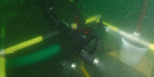 Marine archaeologists have been excavating the shipwreck site.