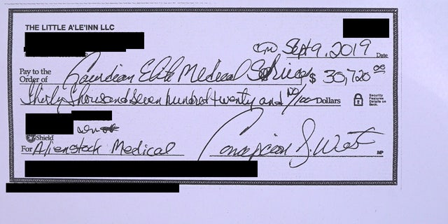 Copy of signed check made out to Guardian Elite Medical Services, which has a contract with Connie West to provide medical teams for AlienStock.