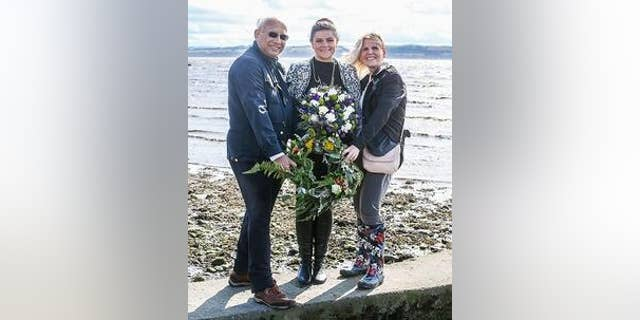 Councillor Julie Ford of Fife Council (center) during the wreath-laying ceremony on Torryburn beach. (Fife Council)