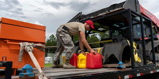 An airman from the Florida National Guard preparing equipment prior to deployment for Hurricane Dorian. (U.S. Air Force photo by Sgt. Christopher Milbrodt)