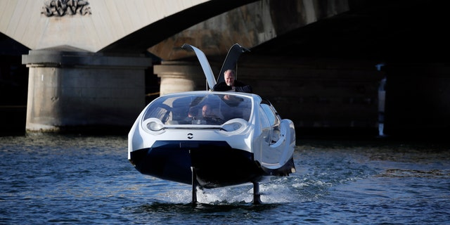 SeaBubbles co-founder Sweden's Anders Bringdal stands onboard a SeaBubble on the river Seine, Wednesday Sept. 18, 2019 in Paris. (AP Photo/Francois Mori)