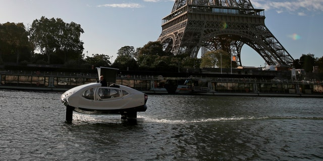 SeaBubbles co-founder Sweden's Anders Bringdal stands onboard a SeaBubble by the Eiffel Tower on the river Seine, Wednesday Sept. 18, 2019 in Paris.