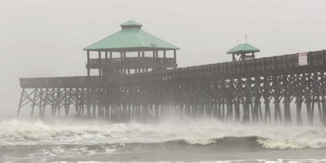 High surf and heavy rain were reported in Folly Beach, S.C., as Dorian neared the area.