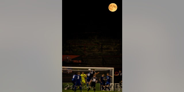 Players from both teams contest a corner under as full moon during the SSE Airtricity League Premier Division match between Bohemians and Waterford at Dalymount Park in Dublin. (Photo By Eóin Noonan/Sportsfile via Getty Images)