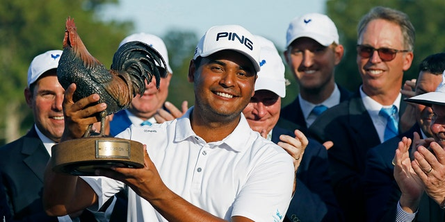 Sebastian Munoz, of Colombia, hoists the trophy after winning the Sanderson Farms Championship golf tournament in Jackson, Miss., Sunday, Sept. 22, 2019. (AP Photo/Rogelio V. Solis)