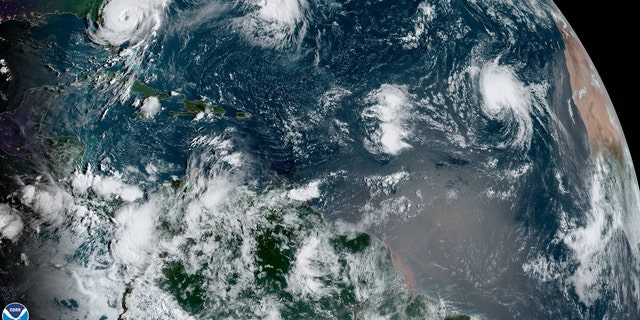 This image, taken on Wednesday, Sept. 4, 2019, shows Tropical Storm Gabrielle in the far-east Atlantic as Hurricane Dorian can be seen spinning just off the coast of Florida.