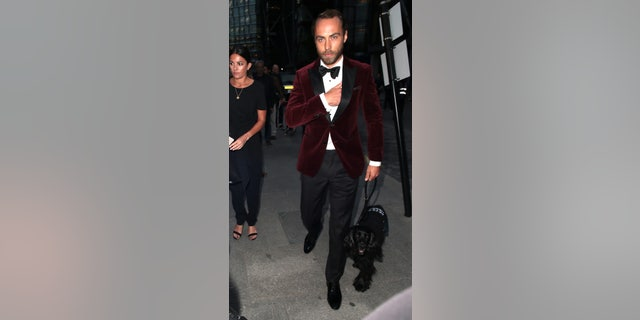 James Middleton attended the GQ Men of the Year Awards in London with his therapy dog, Ella, in tow.