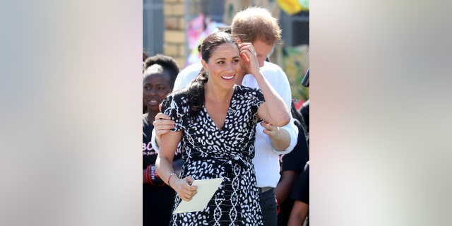 Meghan, Duchess of Sussex, smiles while visiting a Justice Desk initiative in Nyanga County with Prince Harry, Duke of Sussex, during her royal tour of South Africa on September 23, 2019 in Cape Town, South Africa. South. The Justice Desk initiative teaches children about their rights and offers self-defense classes and female empowerment training for girls in the community.