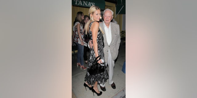 Paris Hilton is seen here with her grandfather, Baron Hilton, in 2010. (Photo by Philip Ramey/Corbis via Getty Images)