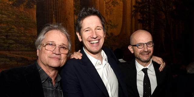 """Attending the after-party for the premiere of Sony Pictures Releasing's """"Resident Evil: The Final Chapter,"""" are, from left, Clint Culpepper, president, Screen Gems; writer/director Paul W.S. Anderson and producer Jeremy Bolt. The event was held at Clifton's Cafeteria in Los Angeles, Jan. 23, 2017. (Getty Images)"""