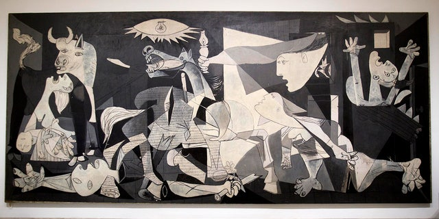"""Pablo Picasso's """"Guernica"""" painting displayed at the Reina Sofia Museum in Madrid. The museum was one of a number of places visited by Raf Casert on a father-son trip to the city with his teenage son."""