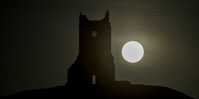 The full Harvest moon rises over the ruins of St Michael's Church a scheduled monument on the top of Burrow Mump on Oct. 5 2017 in Somerset England- File