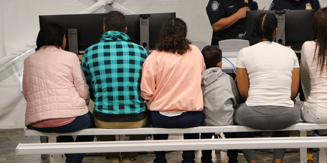 Migrants wait in a processing room in a Migrant Protection Protocol (MPP) center in Laredo, Texas. (Adam Shaw/Fox News)