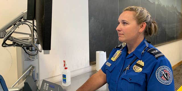 Brenda Irizarry, the lead transportation security officer with the airport, rushed over to perform the Heimlich on the 26-year-old passenger.