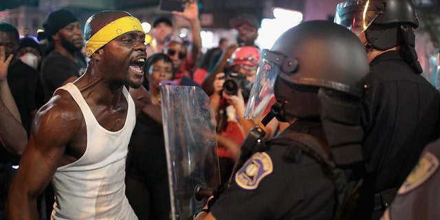 Demonstrators confront police while protesting the acquittal of former St. Louis police officer Jason Stockley in St. Louis, Mo., in September 2017.