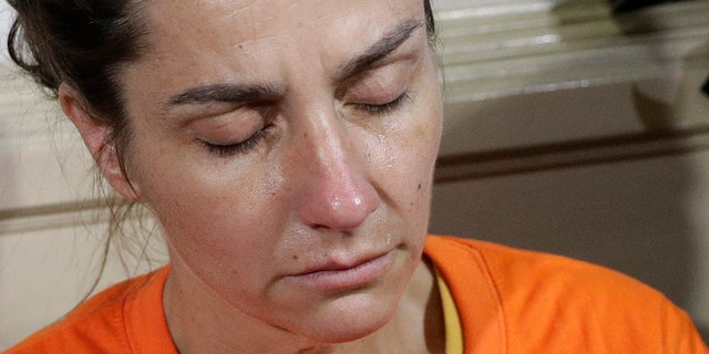 A tear rolls on the cheek of Talbot before the start of a press conference by the National Bureau of Investigation on Thursday. (AP Photo/Aaron Favila)