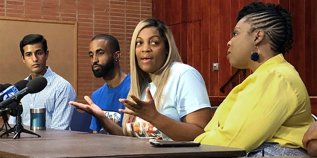 In this Wednesday photo, LaTisha Nixon, second from right, talks about her son Gemmel Moore, one of the men who died in the apartment of Democratic donor Ed Buck, at a news conference in West Hollywood, Calif. (AP Photo/Brian Melley)