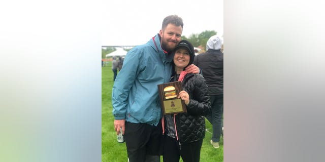 Sam's parents Andy and Kelsey Quarberg, seen here with an award commemorating the burger's third-place win at the Twin Cities Burger Battle. Kelsey birthed their son Sam just seven hours after first eating the burger.