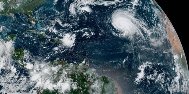 Hurricane Lorenzo can be seen swirling in the eastern Atlantic on Sunday morning.