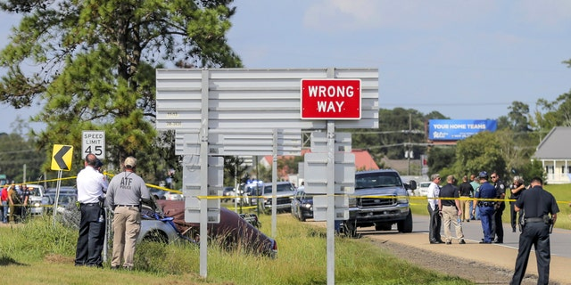 Authorities surround the scene of Friday's shooting in Mandeville, La. (David Grunfeld/The Advocate via AP)