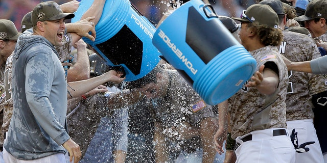 San Diego Padres' Seth Mejias-Brean, center, is doused in a celebration with teammates after hitting a walkoff two-run home run against the Arizona Diamondbacks during the 10th inning of a baseball game in San Diego, Sunday, Sept. 22, 2019. (AP Photo/Alex Gallardo)