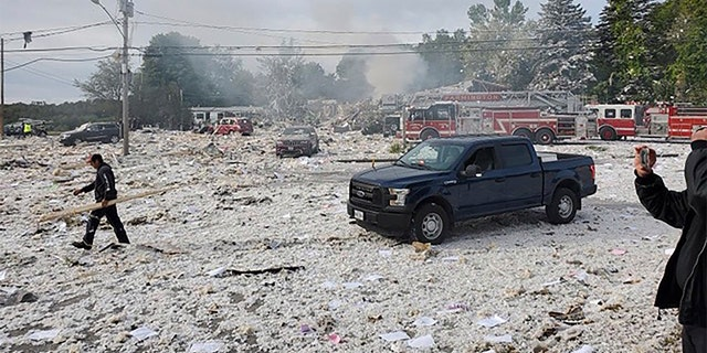 A man working at the scene of the deadly propane explosion Monday. (Jacob Gage via AP)