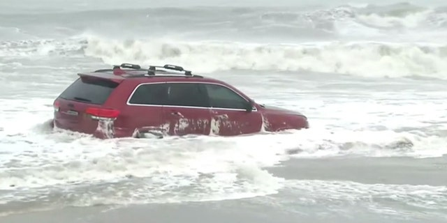 A Jeep SUV can be seen on Myrtle Beach on Thursday as Hurricane Dorian impacted the area.
