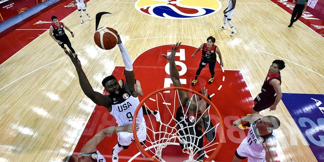 Jaylen Brown, left, of the US fights for the ball with Japan's Rui Hachimura during the Basketball World Cup Group E game between US and Japan in Shanghai, China, Thursday, Sept. 5, 2019. (Hector Retamal/Pool Photo via AP)