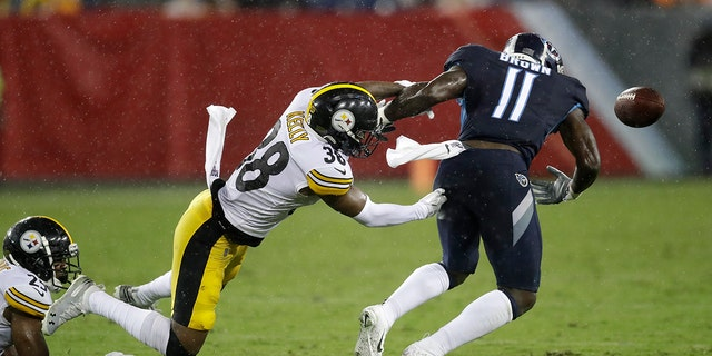 Pittsburgh Steelers defensive back Kam Kelly (38) forces a fumble by Tennessee Titans wide receiver A.J. Brown (11) in the first half of a preseason NFL football game Sunday, Aug. 25, 2019, in Nashville, Tenn. Brown recovered the ball on the play. (AP Photo/James Kenney)
