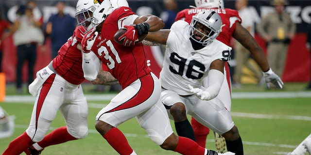 FILE - In this Aug. 15, 2019, file photo, Arizona Cardinals running back David Johnson (31) runs as Oakland Raiders defensive end Clelin Ferrell (96) defends during the first half of an an NFL preseason football game in Glendale, Ariz. (AP Photo/Rick Scuteri, File)