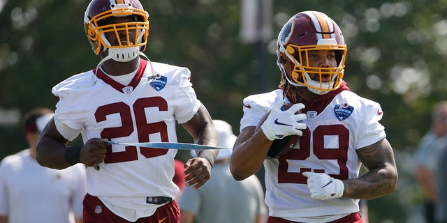 Redskins running backs Derrius Guice, right, and Adrian Peterson are going to play an important role this season. (AP Photo/Steve Helber, File)